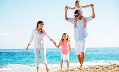 bigstock-Family-having-fun-on-the-beach-60441683