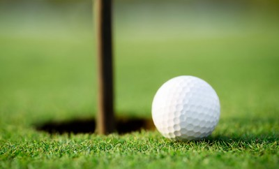 bigstock-Golf-ball-and-hole-48822146
