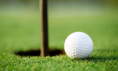bigstock-Golf-ball-and-hole-48822146