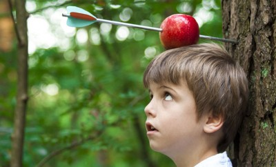 bigstock-Kid-With-Apple-On-His-Head-41207332